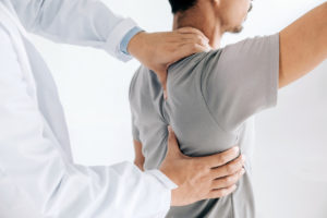 chiropractic care on man's back