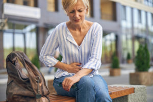 Mature Caucasian lady experiencing a severe stomachache