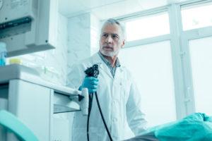 Doctor performing a colonoscopy
